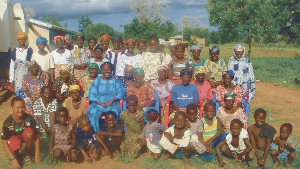Gifty and Kabore with women in Tapko, a village near where she grew up